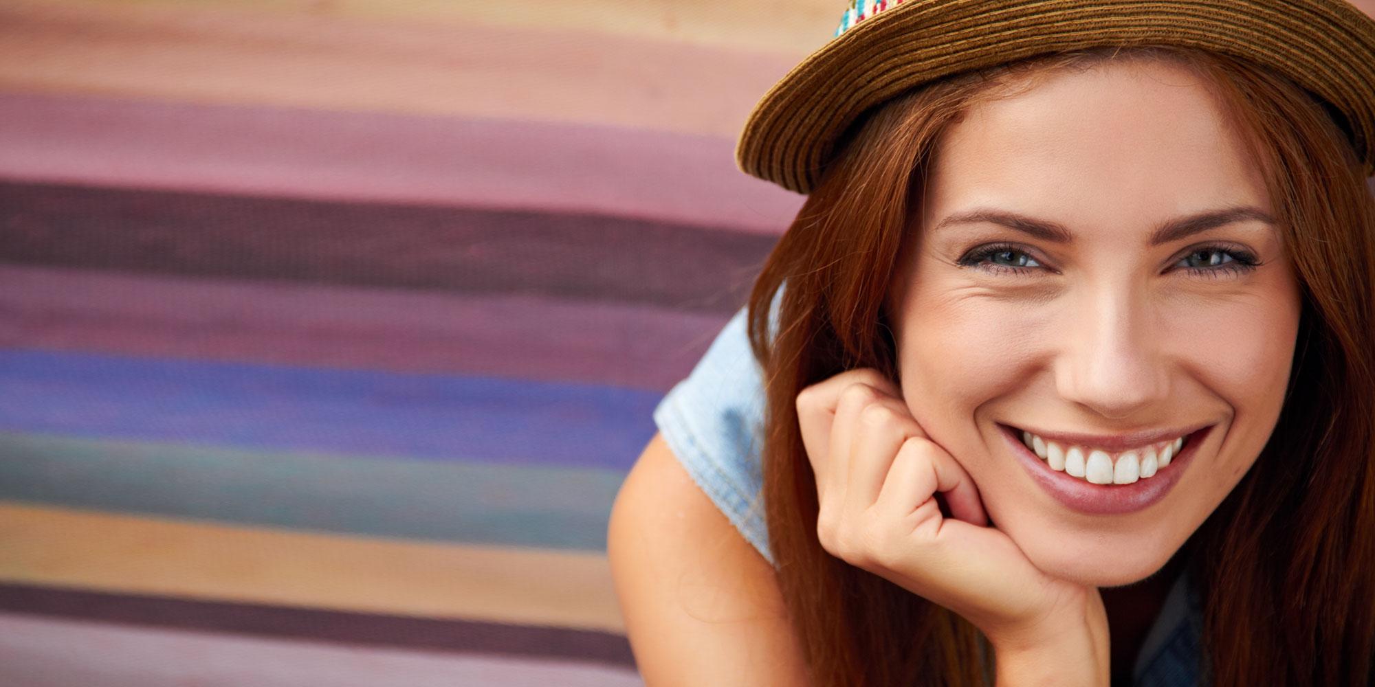 patient smiling after porcelain veneers procedure Brownstown, MI